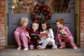 images.jpg Children reading at Christmas