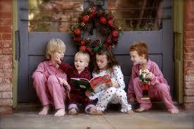 images.jpg Children reading at Christmas
