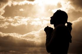 images woman praying with clouds
